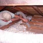 Installer Vacuuming Insulation
